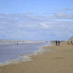 A cold blue sky day over Formby with a surprising gathering of people